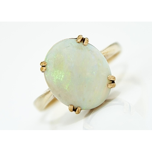 5 - AN OPAL RING, THE CABOCHON 11 X 13MM,  IN 9CT GOLD,  EDINBOROUGH 1978,  4G,  SIZE O...