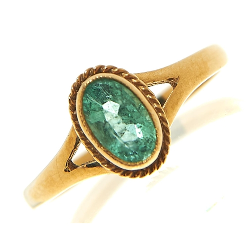 13 - <strong>An emerald ring in 9ct gold,</strong> marks rubbed, 1.4g, size L½...