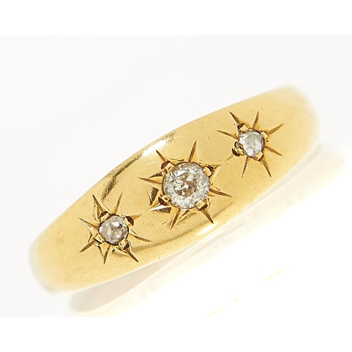 14 - <strong>A three stone diamond ring,</strong> gypsy set in 18ct gold, London 1917, 2.6g, size O...