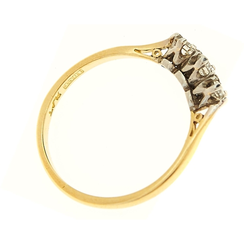 22 - <strong>A three stone diamond ring,</strong> gold hoop marked 18ct plat, 2.1g, size O...