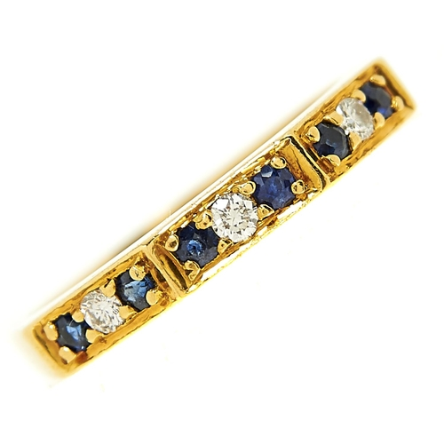23 - <strong>A nine stone sapphire and diamond ring in 18ct gold,</strong> London 1978, 3.3g, size Q...