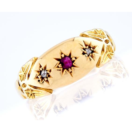 25 - <strong>An Edwardian three stone ruby and diamond ring,</strong> gypsy set in 18ct gold, Birmingham ...