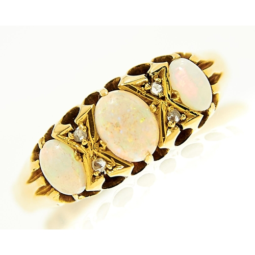 27 - <strong>An opal and diamond ring, early 20th c,</strong> in 18ct gold, Birmingham, no date letter, 3...