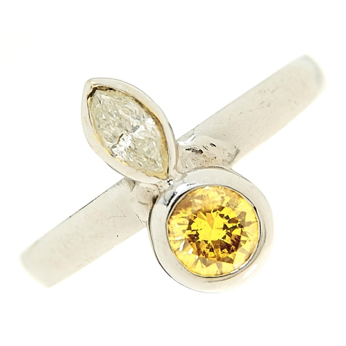 29 - <strong>A diamond and yellow diamond ring,</strong> rub-over set in white gold marked 18ct, 5g, size...
