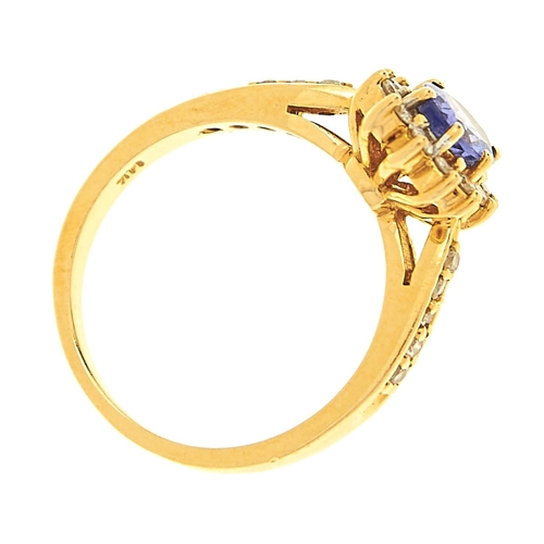 30 - <strong>A tanzanite and diamond cluster ring,</strong> the tanzanite approximately 5 x 7mm, with dia...