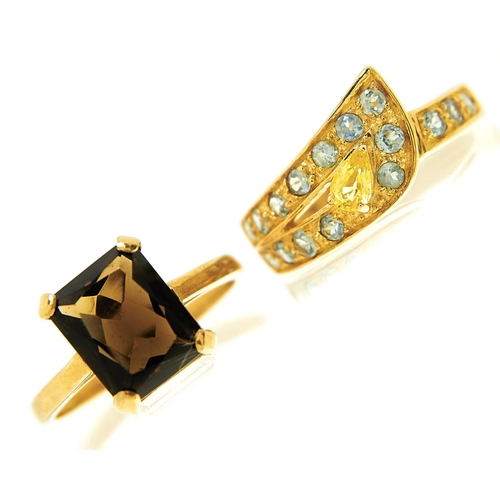 33 - <strong>A smoky citrine ring in 9ct gold,</strong> Birmingham 1995 and a peridot ring in 9ct gold, 7...