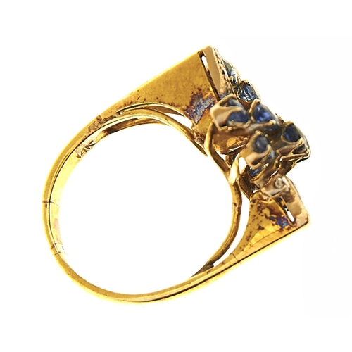 35 - <strong>A sapphire and diamond cocktail ring in 14ct gold,</strong> import marked, London, no date l...