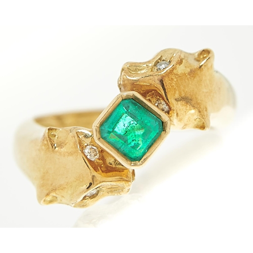 38 - <strong>An emerald and diamond 'big cats' ring,</strong> the step cut emerald approximately 4.5 x 4....