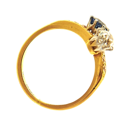 39 - <strong>A sapphire and diamond crossover ring, early 20th c,</strong> the old cut diamond of approxi...