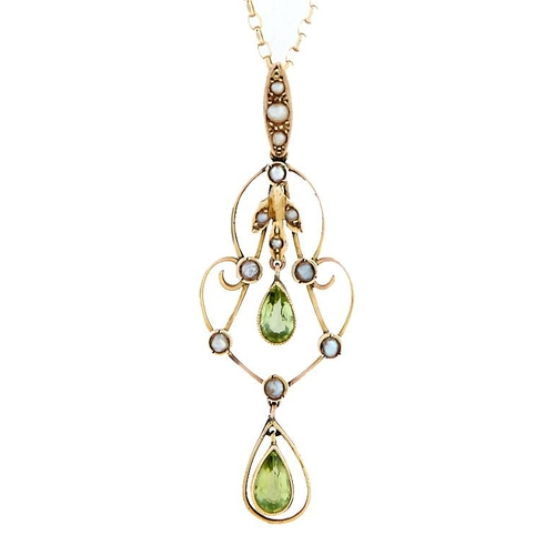 44 - <strong>A peridot, split pearl and gold openwork pendant,</strong> early 20th c, with split pearl se...