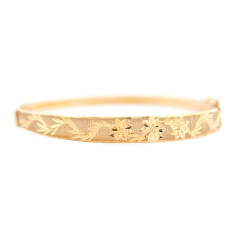 50 - <strong>A 9ct gold bangle,</strong> 60mm, import marked Birmingham 1993, 5.6g...