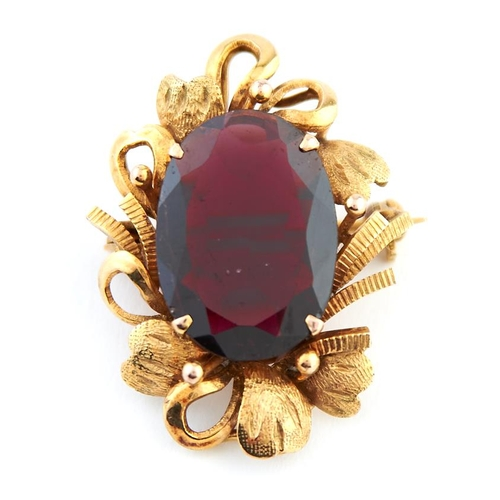 55 - <strong>A gem set gold brooch-pendant,</strong> 30mm, marked 18k, 6.9g...