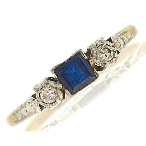 57 - <strong>A sapphire and diamond ring,</strong> the step cut sapphire approximately 4 x 4mm, flanked b...