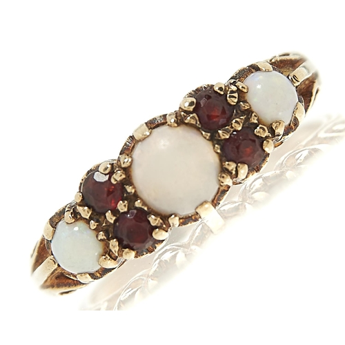 58 - <strong>An opal and garnet ring,</strong> in 9ct gold, London 1971, 3.4g, size Q...