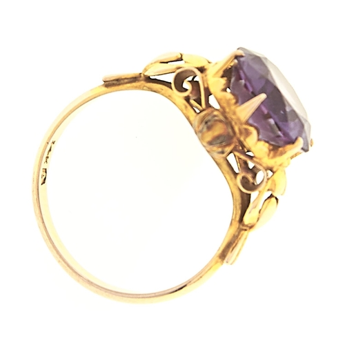 59 - <strong>An amethyst ring,</strong> in gold marked 14k, 3.9g, size L½...