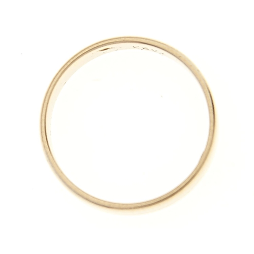 60 - <strong>An 18ct white gold wedding band,</strong> Birmingham 1971, 3.7g, size O...