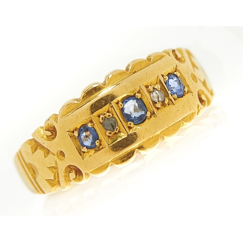 9 - <strong>A Victorian five stone sapphire and diamond ring</strong> in 18ct gold, Chester 1900, 2.1g, ...