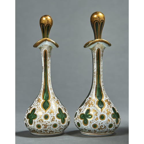 934 - A pair of cased glass scent bottles and stoppers, mid 19th c, of green glass cased in white, having ...