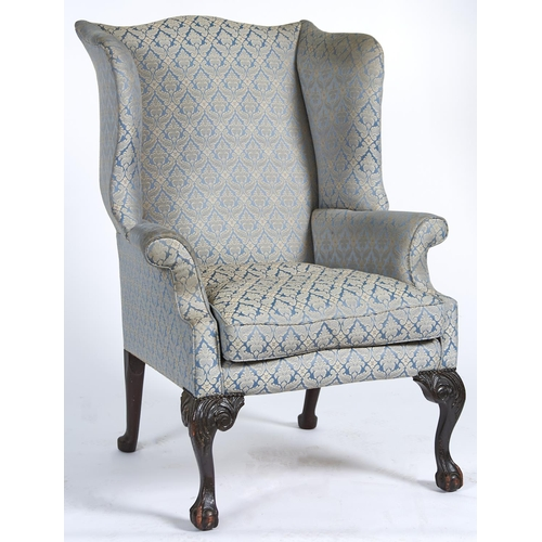 1428 - A George II mahogany framed wingback armchair, c1770, the serpentine shaped back, wings, arms and lo...