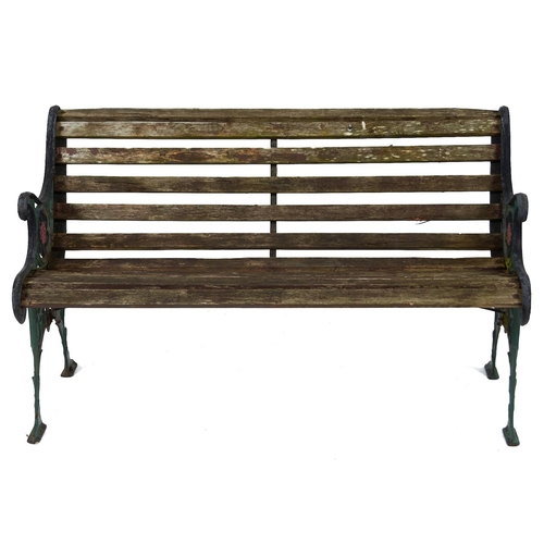 1461 - A cast metal garden seat, second half 20th c, slatted seat, the ends pierced and cast with flowerhea...