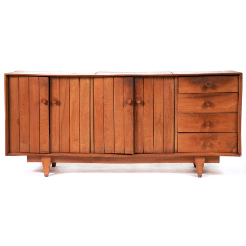 1465 - A mid century ash sideboard, c1960, the top with flush lidded central cutlery compartment with brass...