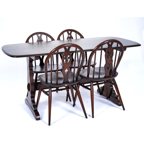 1476 - An Ercol elm dining table and set of four chairs, modern, the rounded rectangular top above trestle ...
