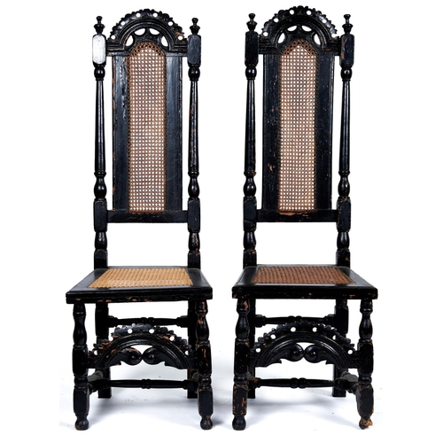 1483 - A pair of Queen Anne walnut high back caned chairs, c1700, with pierced arched cresting rails above ...