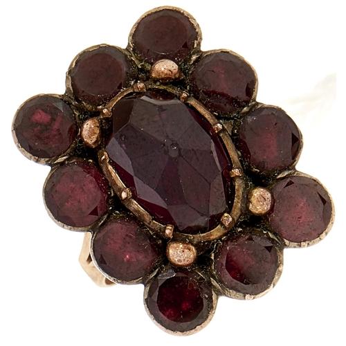 10 - A Georgian garnet ring,adapted from a brooch, gold hoop, 7.4g, size M