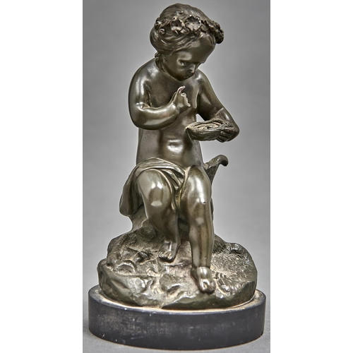 1009 - A bronze statuette of a child, late 19th c, seated on a stump holding a bird's nest, even greenish d...