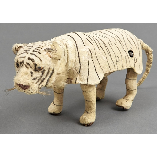 1016 - A Roullet & Decamps pouncing tiger automaton, 20th c,with glass eyes, 17cm h approx...