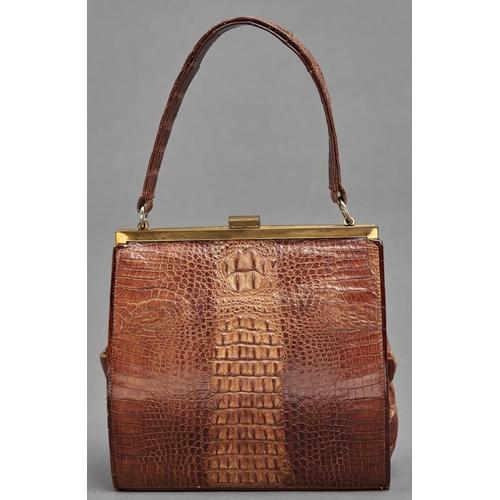 1026 - A giltmetal mounted crocodile skin evening bag, c1960's, with printed mark Gunning Crocodile Made in...
