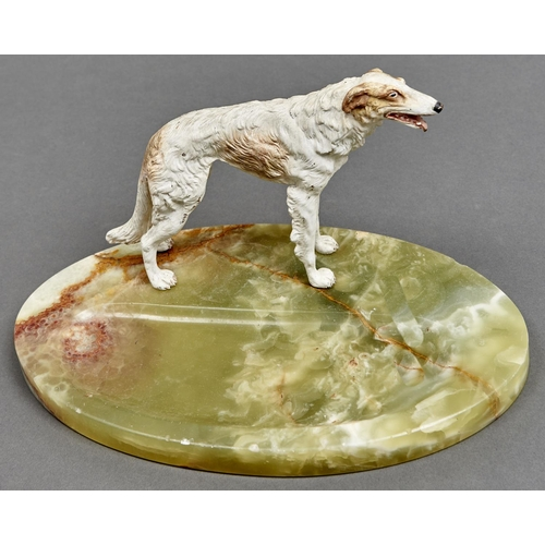 1029 - An Austrian cold painted bronze sculpture of a Borzoi, on oval onyx desk tray, c1930, 33cm l...