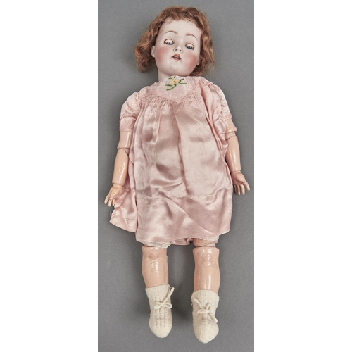 1038 - A German character doll, early 20th c, the bisque head with weighted blue glass eyes and open mouth...
