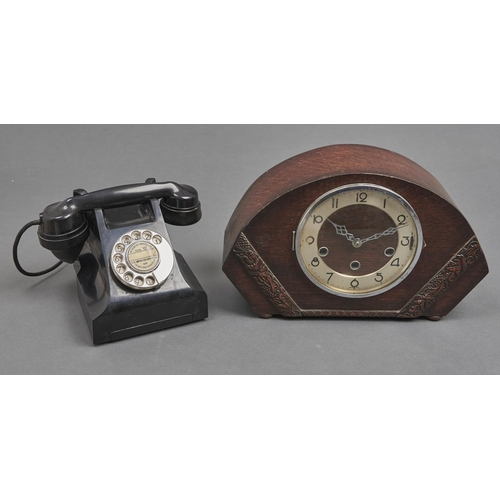 1045 - A T E L black Bakelitetable telephone, the underside marked JL 11560 A6 and an oak mantel clock wi...