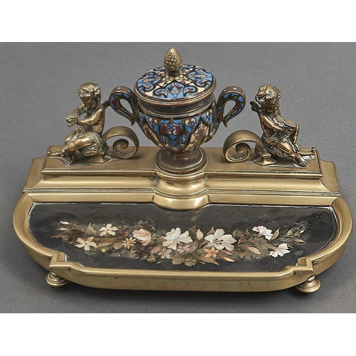 1058 - A French gilt brass champleve enamel and pietre dure inset inkstand, c1880, the shield shaped inkwel...