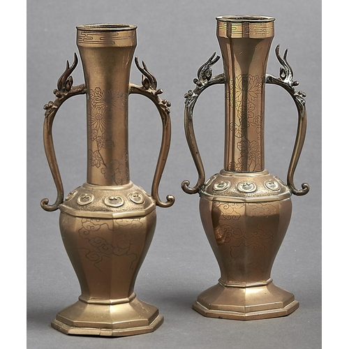 1061 - A pair of Chinese brass vases, third quarter 19th c, the tall tubular necks spreading at the top and...