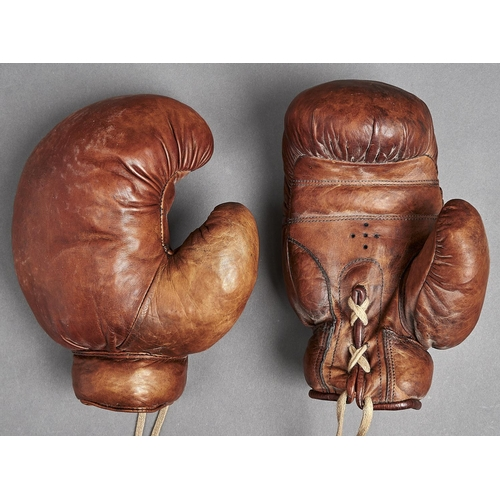 1069 - Boxing. An antique pair of leather boxing gloves, early 20th c