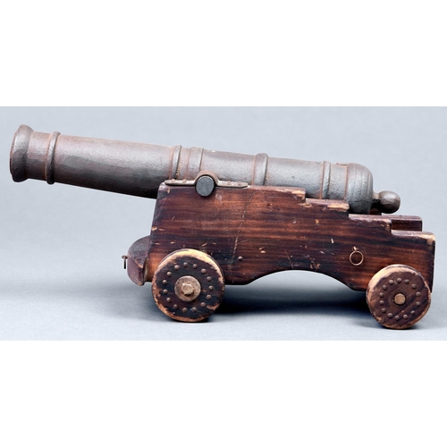 1080 - An iron model 1812 cannon on stained wood carriage, 20th c, barrel 36cm l
