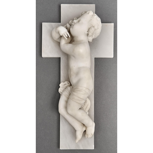 1086 - An Italian alabaster carving of a cherub and crucifix, the reverse with trade label for Giuseppe And...