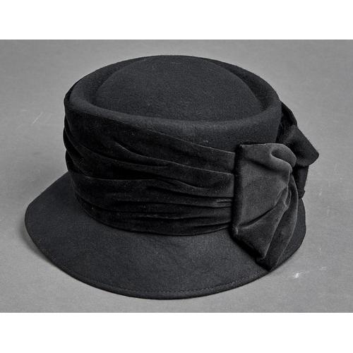 1101 - Millinery. A black felt lady's hat with velvet bow by Sandra Phillipps