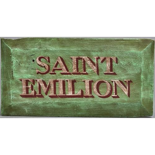 1127 - A decorative painted wood name board - Saint Emilion, 20th c, chamfered edges, 30 x 59cm...