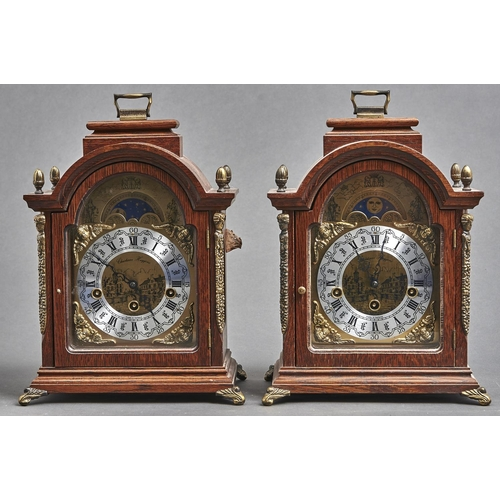 1133 - A pair of reproduction giltmetal mounted oak arch top bracket clocks, the silvered and brass dial wi...
