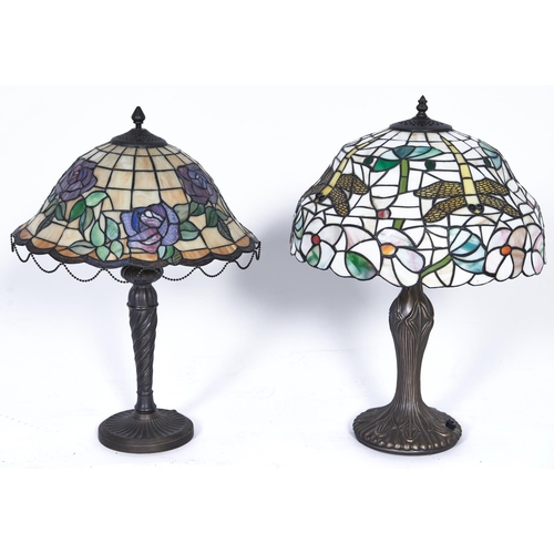 1134 - Two Tiffany style table lamps, the coloured glass shades decorated with roses and dragonfly's, 56cm ...