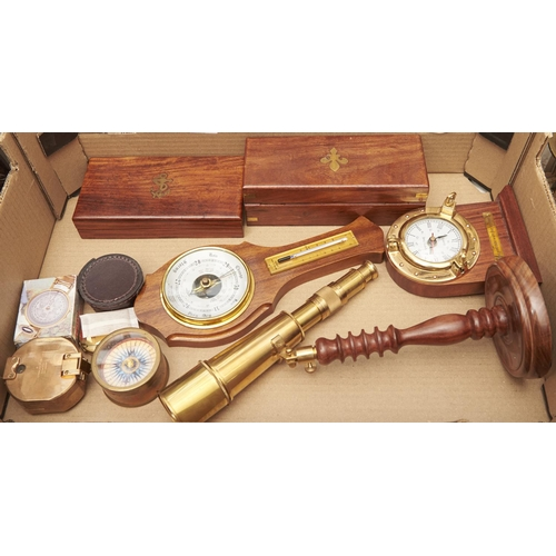 1179 - A Stanley & Co reproduction brass compass, reproduction brass telescope on turned wood stand, bo...