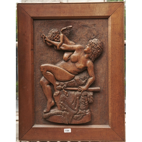 1180 - A carved oak bas relief panel, first half 20th c, of a bacchante and cupid, in oak frame, 75 x 58.5c...