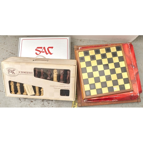 1207 - A Sherlock Holmes chess set by The Traditional Games Company Ltd, boxed (2), another chess set of fa...