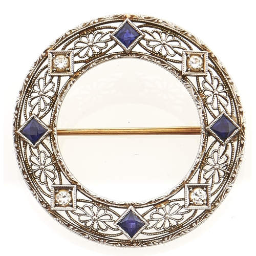 139 - A diamond and sapphire brooch, in gold marked 14k, 5g