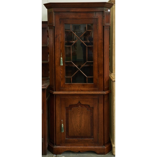 1400 - An antique style oak glazed corner cupboard, the lower part with panelled door, 191cm h x 89cm w...