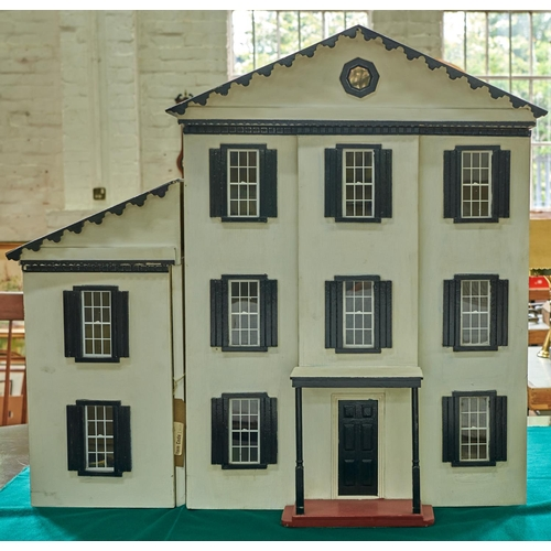 1403 - A painted wooden doll's house, mid 20th c, grey roof, white painted with black framed windows and po...