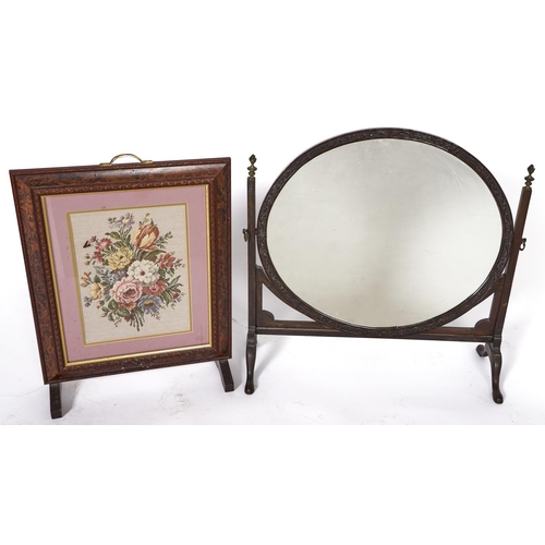 1410 - A Victorian carved mahogany dressing mirror with oval plate, 70cm w and a later firescreen with need...